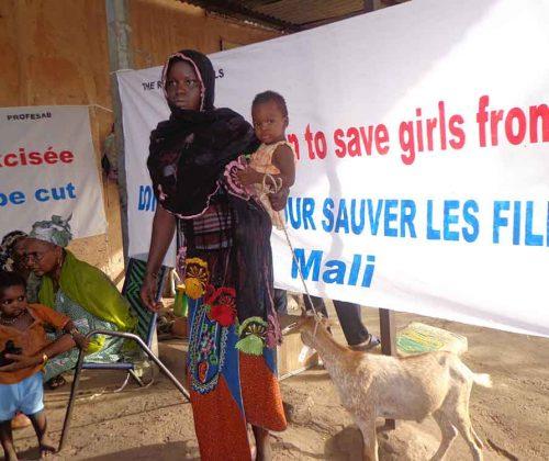 Awa Diarra with mum and goat